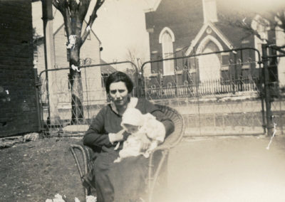 woman holding baby with St. James Catholic church in background