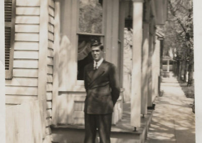 Richard Haynes in front of house on St. Paul Street.